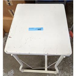 2 metal rolling tables, floor lamps and multiple set of tarps