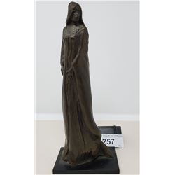 Bronze Statue Of A Lady