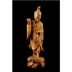 Basswood Carved Chinese Fisherman Holding A Fish