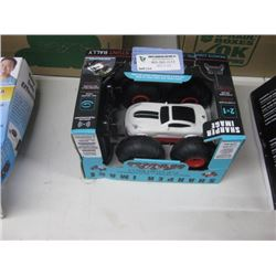 SHARPER IMAGE REMOTE CONTROL STUNT CAR