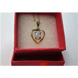8)  GOLD TONE HEART PENDANT WITH OVAL