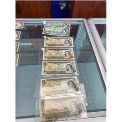 7 CANADIAN $1 BILLS