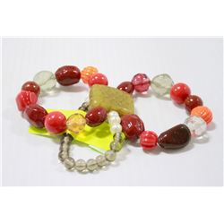 ASIAN BEADED BRACELET WITH CARVED JADE CENTRE