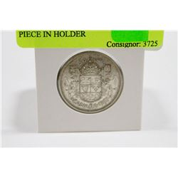 1957 CANADIAN SILVER 50 CENT PIECE IN HOLDER