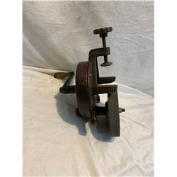 Hand operated bench grinder