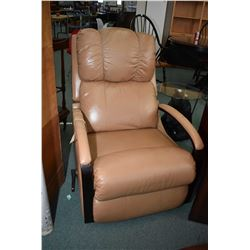 Tan leather swivel recliner with open arms and wood accents