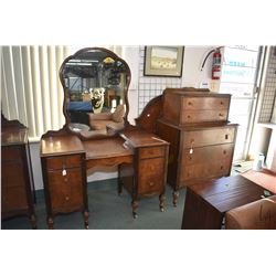 Four piece mid 20th century walnut bedroom suite including mirrored vanity, mirrored four drawer dre