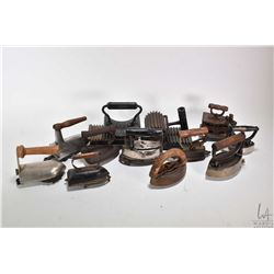 Selection of vintage cast irons and two fabric fluters plus a selection of small trivets