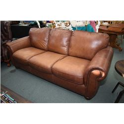 Full size over stuffed brown leather sofa with nail head decoration