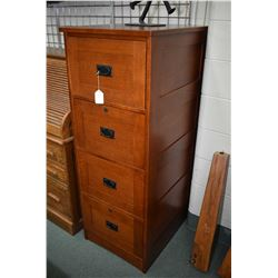 Modern mission style oak four drawer filing cabinet can be set up for legal or letter side made by W