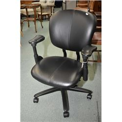 H.E. by Haworth ergonomic office chairs, appears in near new condition
