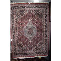 100% wool area carpet with center medallion, red background and overall geometric floral design with