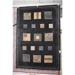 """Wool area carpet with black background and earth toned geometric patchwork decoration, 63"""" X 90"""""""
