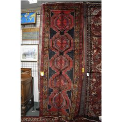 100% handmade wool carpet runner Sarab with multiple medallions and highlights of red, blue and brow