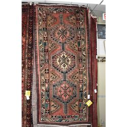100% handmade wool carpet Sarab with triple medallion, soft red background and highlights of green,