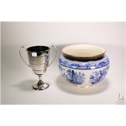 "Antique glazed blue and white planter 8"" in height and a vintage silver-plate loving cup trophy pres"