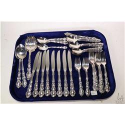 Selection of silver-plate flatware including eight each of dinner knives, dinner forks, dessert fork