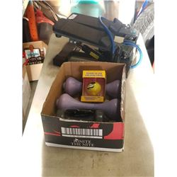 Box of dumbbells and stress relief ball with stepper exerciser