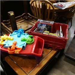 Tote of star wars toys may be missing parts with hungry hungry hippos game and eating trays
