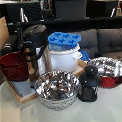Tray of slow cooker with mixing bowls, caraffe, planters and tea light lantern