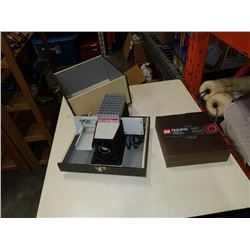 Bell howell slide projector and tray of slides