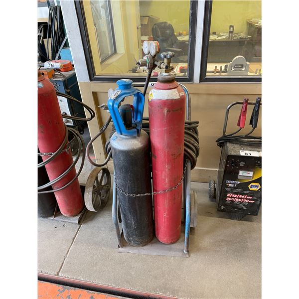 BLUE INDUSTRIAL TORCH CART WITH HOSE, GAUGES, AND TORCH HEAD