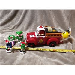 M&M fire truck dispenser and four toys