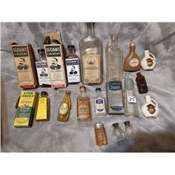 Old medicine and other bottles, shakers