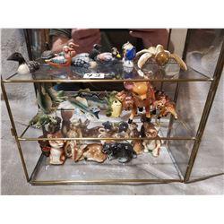 Glass display case full of nice figurines