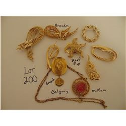GOLD TONE JEWELRY: BROOCHES. TIE CLIP, NECKLACE,/PENDANT