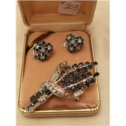 """203.  Blue and clear rhinestone broach and clip earrings marked """"Ciner"""""""