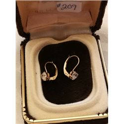 209.  10 KT gold and cubic zirconia pierced earrings
