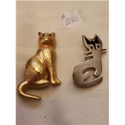 210.  Sterling silver cat and a gold tone cat (2)