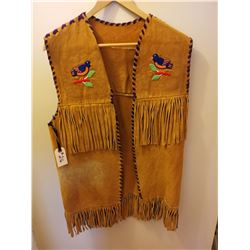 216.  Fringed beaded vest, some damage and fading