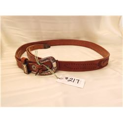 217.  Tooled leather belt with sterling chased buckle, note extensions