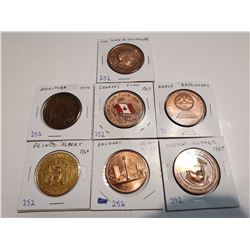 7 large size tokens, great condition