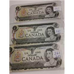 Three replacement 1973 $1 bills, different prefixes