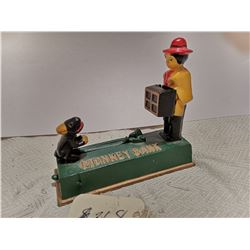 Vintage mechanical cast iron monkey bank
