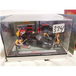 Schuco diorama garage 1:43 scale, black porsche car