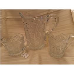 403.  Cut Glass Pitcher and cream and sugar, arched panels with rosettes and starbursts