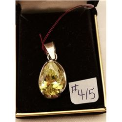 415.  Sterling silver (925) pendant with peridot stone