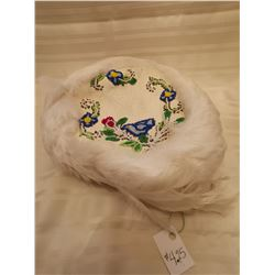 425.  Regalia, hat made of caribou, feather band, beaded flowers