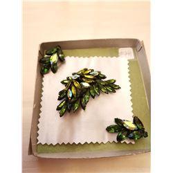 """441.  Smokey green rhinestone broach and earrings, japanned, marked """"Regency"""""""