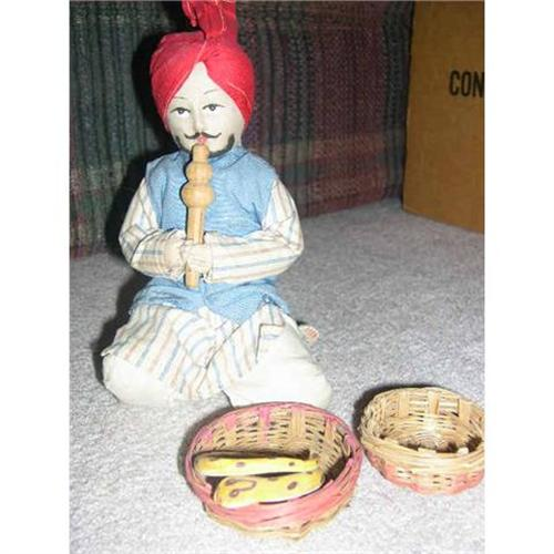 India Snake charmer with pipe, basket and snake#1468970