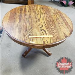 """Oak Pedestal Dining Table with 2 Leaves (45"""" Round w/o Leaves) (63"""" L with Leaves) (45""""W)"""