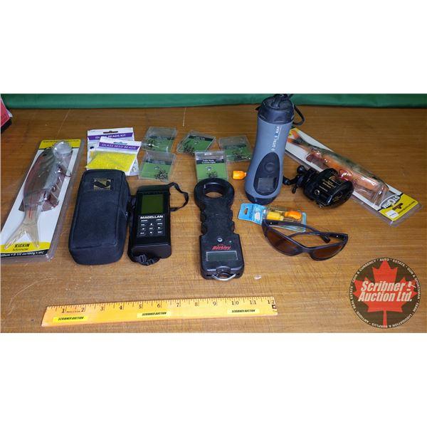 Tray Lot: Magellan GPS 2000, Hawkeye Handheld Digital Sonar System, Rapala Sunglasses, Berkley Elect