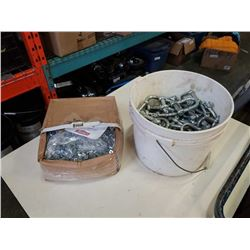 Box of square nuts and bucket of shackles