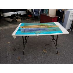 Folding table and drafting supplies