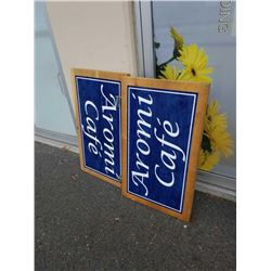 Two hanging wood signs 22.5 inch by 38 inch