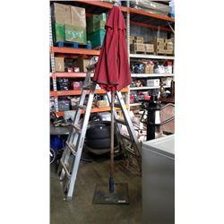Cast iron umbrella stand and patio umbrella